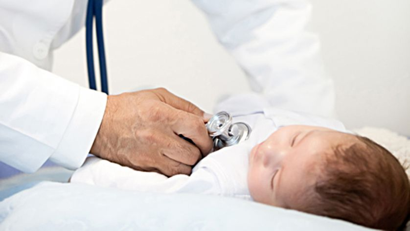 Doctor listening to a baby heart