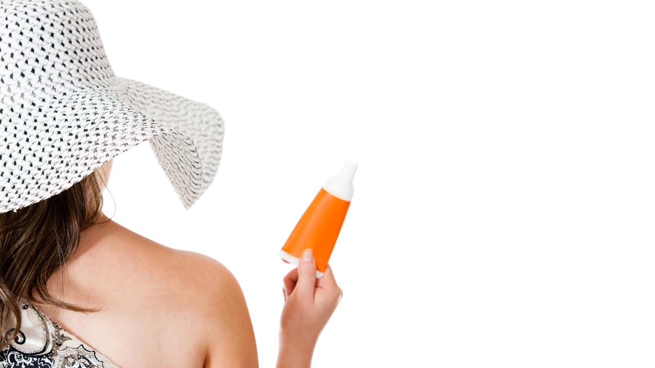 Woman wearing sunblock