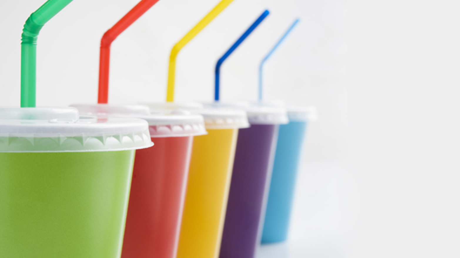 Row Of Plastic Soft Drink Cups With Straws